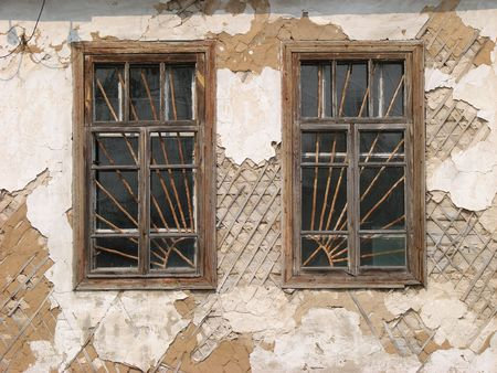 Two alone aged ruined urban windows photo