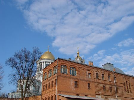 atone: Cathedral red brick wall under deep blue sky Stock Photo