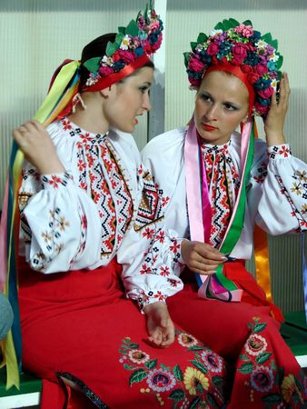 Two ukrainian girls in colorful national folk costume photo