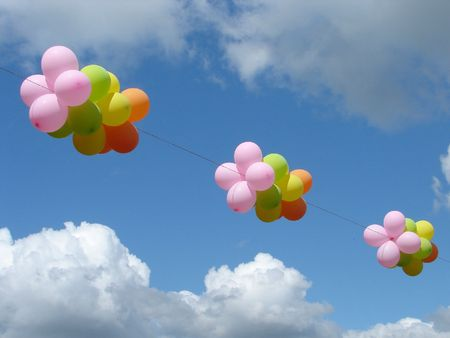 Multicolored colourful ballons in cloudy blue sky Stock Photo - 1365253