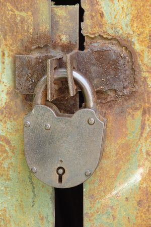 Wintage rusty metal gate padlock photo