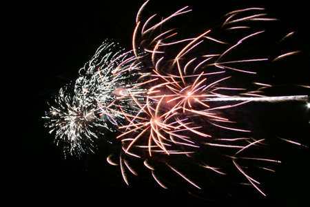 actual: Night celebration fireworks upon dark sky