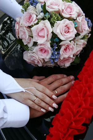 Female and male hands of newlyweds with bouquete Stock Photo - 1767947