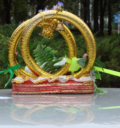 Wedding car decoration with two and gold rings and bells photo