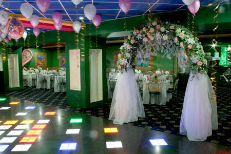 light meal: Wedding party hall decoration with white veil arc Stock Photo
