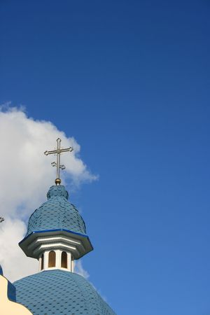 yielding: Blue cloudy sky with with blue church cupola Stock Photo