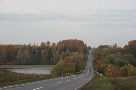 both sides: Autumn highway with yellow trees on both sides Stock Photo