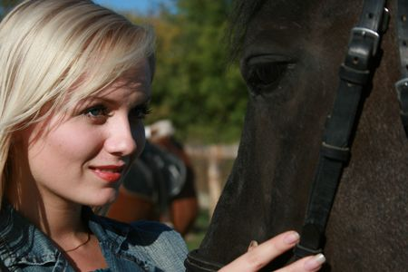 gesticulate: Blond female model with brown horse close-up portrait Stock Photo