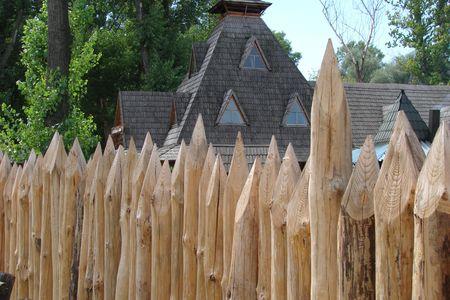 garrison: wooden sharp logs palings barrier wall