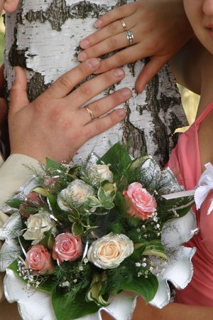 Female and male hands of newlyweds with bouquete Stock Photo - 2173641