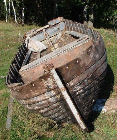 ruined vintage wooden boat on riverside Stock Photo - 2211434
