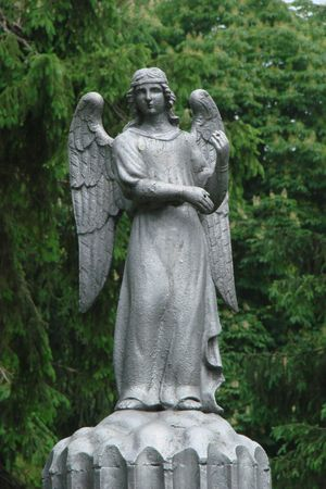 Metall angel figurine decoration in ancient cemetery photo