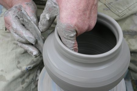 hands of potter shaping glue vase 3