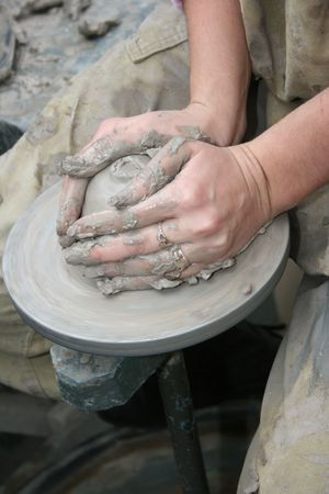 hands of potter shaping glue vase 4 Stock Photo