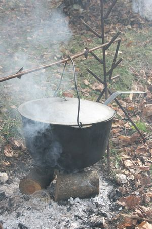 Cooking with black pot on opened wood fire Stock Photo - 2287707