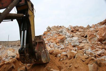 Scoop of a huge excavator in sand opencast