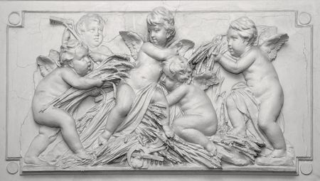 Stony embossed carving of angel figurines architecture decoration photo