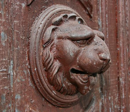 vintage ancient wooden door lion head decoration photo