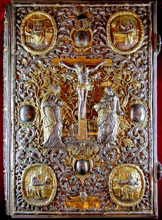 yielding: heavy rich golden cover of Orthodox Gospel or Bible