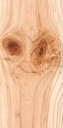 Knots on textured wooden plank like alien face Stock Photo - 2449320