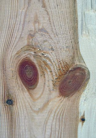 separate: Knots on textured wooden plank like alien face Stock Photo