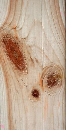 loneliness: Two knots on textured wooden plank like alien face