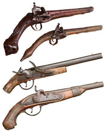 Isolated vintage firearm pistols of XIVII-XIX centuries Stock Photo