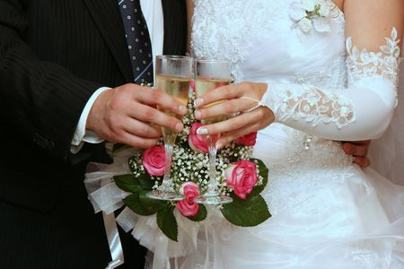 Female and male hands of newlyweds with champagne cups Stock Photo - 3312901