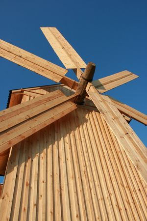 Rural wooden windmill against clear deep blue sky Stock Photo - 3666735