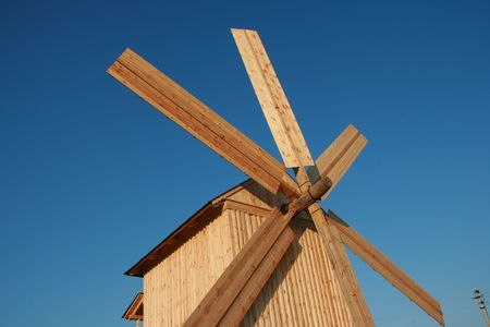 Rural wooden windmill against clear deep blue sky Stock Photo - 3666730