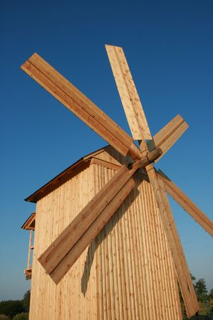 Rural wooden windmill against clear deep blue sky Stock Photo - 3666733