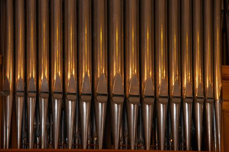Vertical row of old shiny organ metal pipes