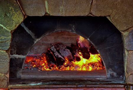 firing coals in home old brick fireplace Stock Photo