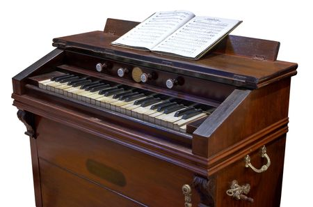 clavier: antique foot-propelled reed-organ or clavier Stock Photo