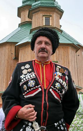 papakha: Ukrainian cossack general under wooden church Stock Photo