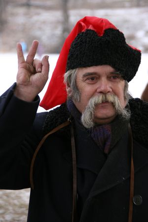 papakha: Old ukrainian Cossack with OK or Victory gesture