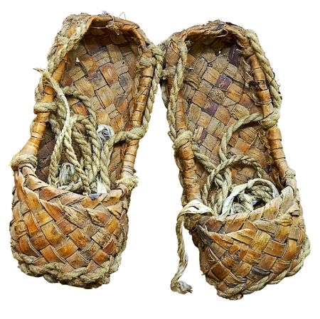 bast: woven bast sandals of ancient Slavic Russia poor peasant Stock Photo