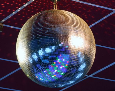night club lighting blue mirror-ball over curtains