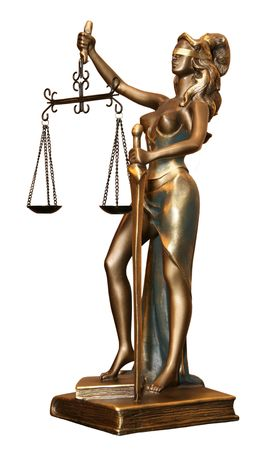 Golden statuette of justice goddess Themis or Nemesis  with scales and sword photo