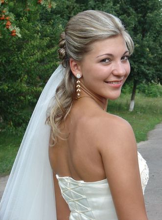 fiance: Young nice bride in wedding dress Stock Photo