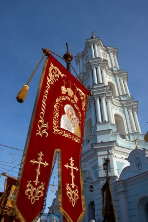 sumy: White church belfry and gonfalon under deep blue sky