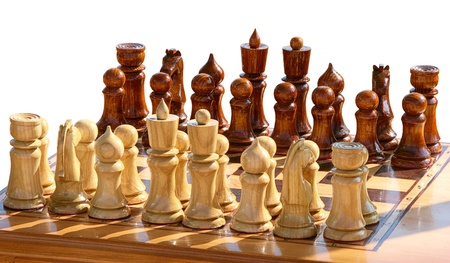 Isolated set of chess figurines on playing board photo