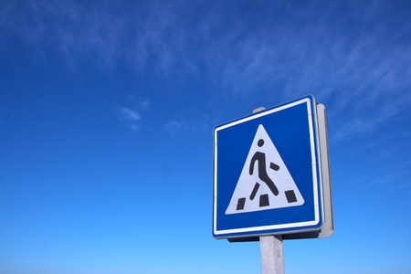 trafic stop: Road pedestrian crossing sign against clear deep blue sky