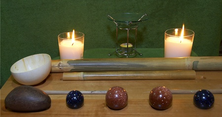 Set of bamboo and pebble instruments for Asiatic spa massaging photo