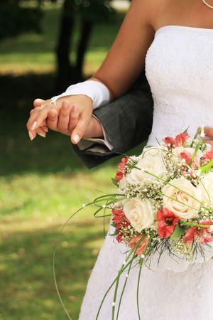 True wedding photo, bride and bridegroom hold beautiful bouquet Stock Photo - 9568392