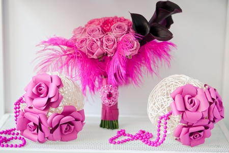 Bridal  pink bouquet of roses and feathers with two white spheres of bars decorated of beads and paper flowers Stock Photo - 9568493