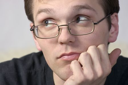 woebegone: thoughtful young man in spectacles
