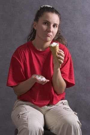 scruple: girl with tablets and icecream Stock Photo