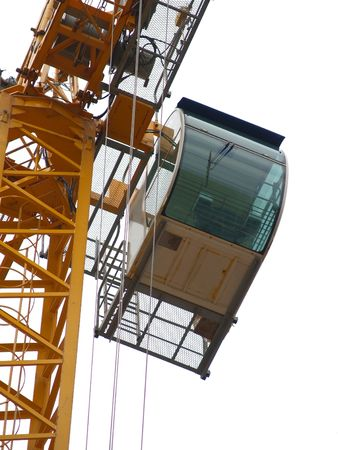 Crane detail: cabin. Brussels European quarter. Almost isolated on white.