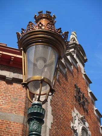 Old lamp post on Brussels St.G�ry square. photo
